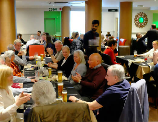 Curry lovers raise £1,500 for Emmaus Burnley