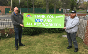 Companions hold banner thanking NHS staff and key workers